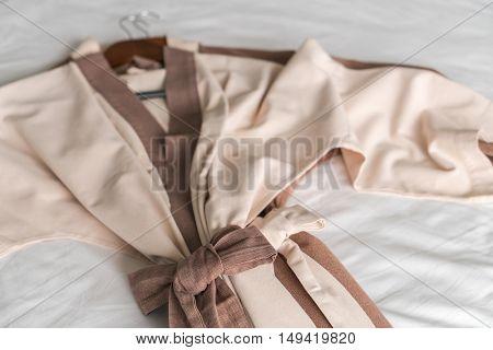 Clean bathrobe  on bed