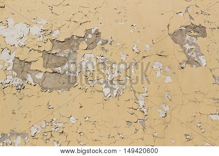Background of old yellow painted cracked wall