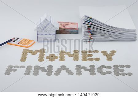 House And Money With Pile Overload Document With Colorful Paperclip