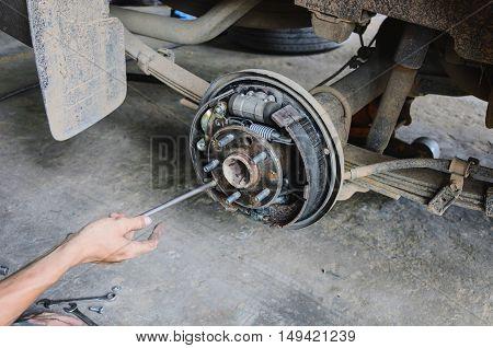 mechanic changing maintenance Disc brake on car