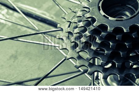 Part of rusty bicycle gear cassette (selective focus) vintage effect
