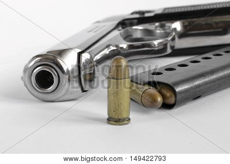 Pistol and ammunition on the white background.