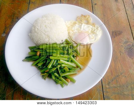 Food Thai In Asian, Green Morning Glory Vegetable Fried Oil With Garlic Food On Wood Table At Outdoo