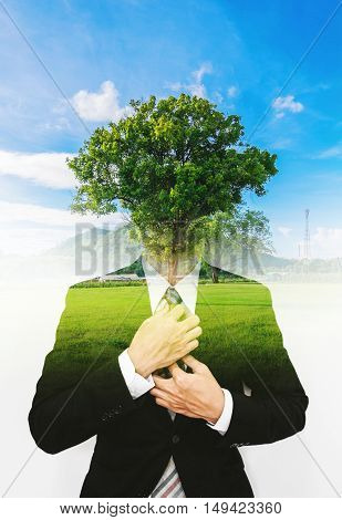 Double exposure businessman with a tree with blue sky, ecology friendly concept, Think Green