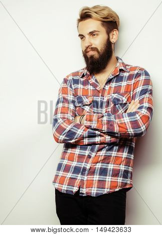 portrait of young bearded hipster guy smiling on white background close up, brutal man, lifestyle people concept