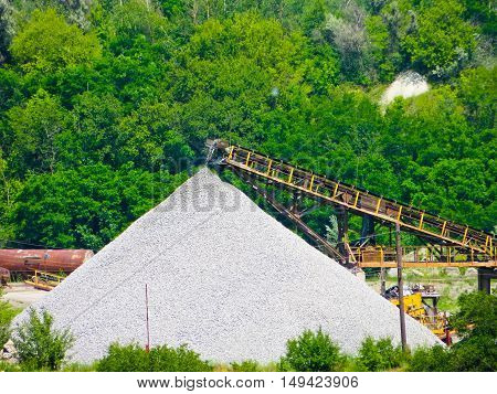 conveyor with piles of gravel granite quarry