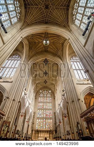 Bath UK - August 15 2015: Interior view of Bath Abbey. Symmetrical low angle view. The abbey is an Anglican parish church and an active place of worship