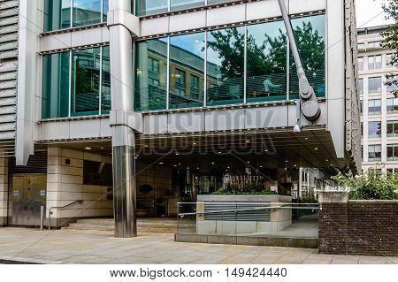 LONDON UK - AUGUST 21 2015: Entrance of Lloyds Banking Group Headquarters building. It´s an office building designed by Grimshaw architectural firm