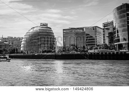 LONDON UK - AUGUST 22 2015: London City Hall from the river a sunny day. Black and white artistic image. It was designed by architect Norman Foster