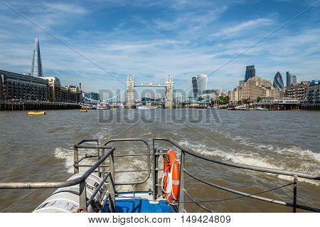 LONDON UK - AUGUST 22 2015: London riverside from a boat: Tower Bridge the Shard Docks The City.