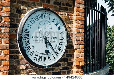 LONDON UK - AUGUST 22 2015: The Shepherd gate 24-hour clock outside the Royal Greenwich Observatory. Galvano magnetic clock.