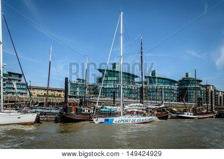 LONDON UK - AUGUST 22 2015: Modern housing and sailing boatsd in London riverside near Tower Bridge