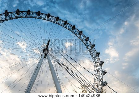 LONDON UK - AUGUST 23 2015: London Eye low angle view a cloudy day near sunset