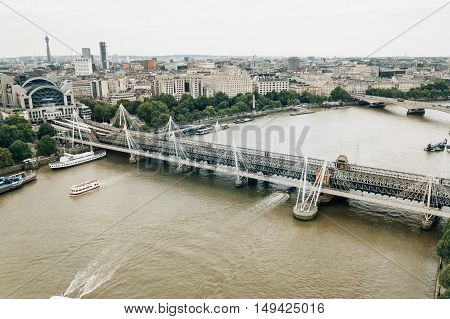 LONDON UK - AUGUST 23 2015: Aerial view of London from London Eye. Hungerford and Golden Jubilee Bridges
