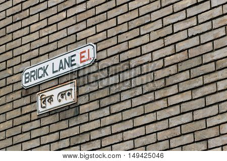 LONDON UK - AUGUST 23 2015: Brick Lane street sign London UK. English and arab.