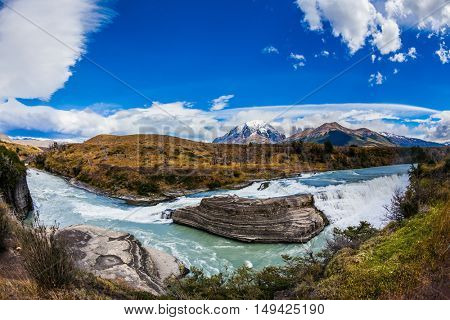 Chile, Patagonia, Paine Cascades. Torres del Paine National Park - Biosphere Reserve. Rocky ledges Paine river forms a cascading waterfalls