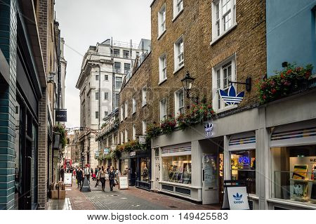 LONDON UK - AUGUST 20 2015: View of Foubert Place near Carnaby Street with people shopping. Carnaby Street is a pedestrianised shopping street in Soho in the City of Westminster London