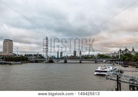 LONDON UK - AUGUST 20 2015: London cityscape at sunset: Big Ben and London Eye