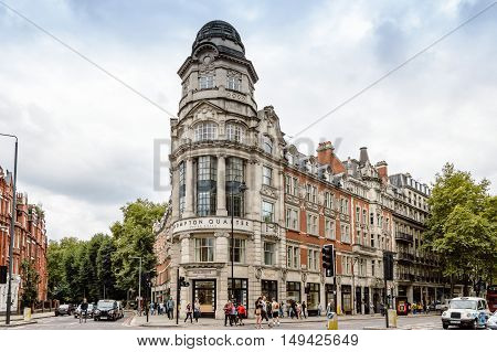 London UK - August 19 2015: Brompton Road is a street in Knightsbridge London. It is home to many expensive shops fashion houses and luxury apartments