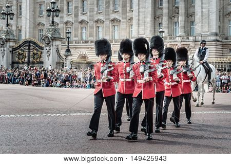 London UK - August 19 2015: Royal Guards parade during traditional Changing of the Guards ceremony near Buckingham Palace. This ceremony is one of the most popular tourist attractions in London.