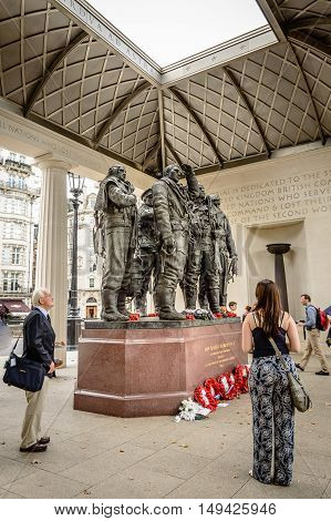 London UK - August 19 2015: People at The Bomber Command Memorial commemorates the 55573 who died while serving in the Bomber Command during the Second World War.