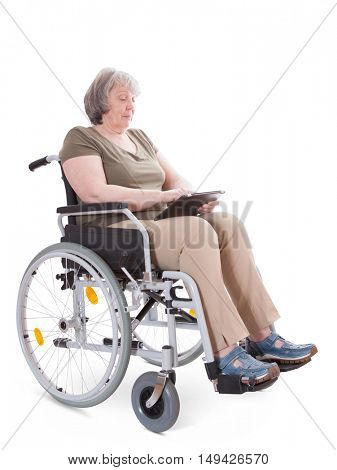 Senior sitting in wheelchair using tablet device. All on white background.