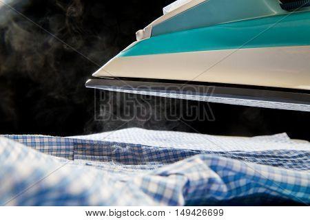 Modern Hot Iron Over Blue Shirt