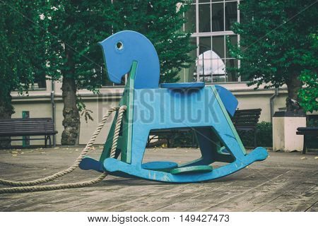 children	s toy wooden horse, blue horse on site