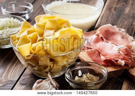 Ingredients Ready For Preparing Pappardelle With Prosciutto And Cheese Sauce