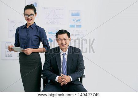 Portrait of Vietnamese businessman and his female assistant