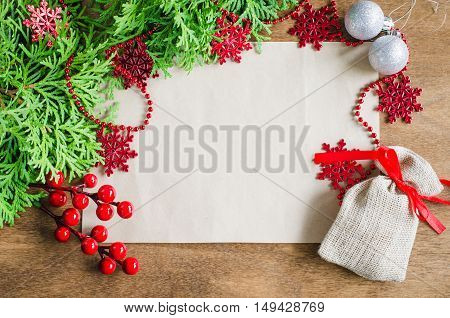 Christmas background with xmas decoration blank postcard on wooden background. Copy space. Merry christmas. Selective focus space for text.
