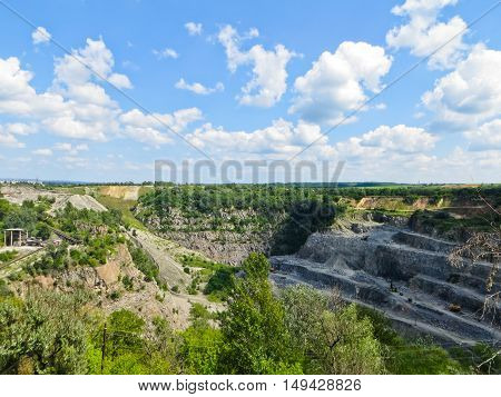 Granite quarry under the blue sky, industrial landscape