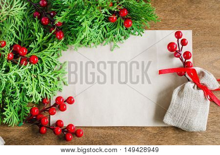 Xmas decoration with blank postcard on wooden background. Copy space. Seasonal and holidays concept. Selective focus space for text.