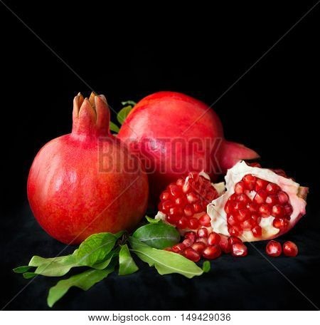 three sweet red pomegranate on the table