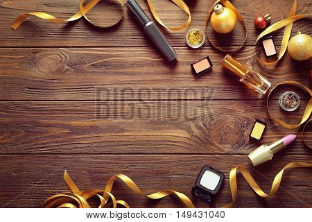 Colorful makeup cosmetic with Christmas decoration on wooden background