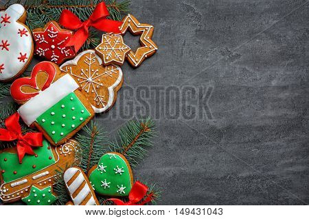 Delicious cookies with Christmas decoration on gray background
