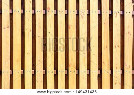 Background Of Fence With Yellow Vertical Wooden Planks