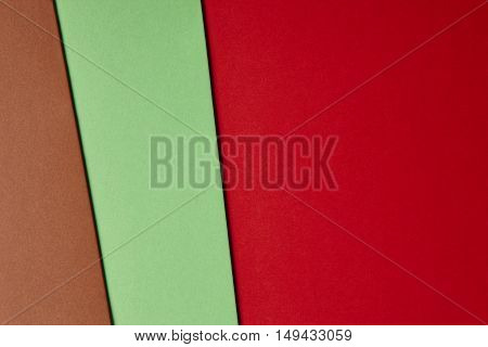Colored cardboards background brown green red tone. Copy space. Horizontal