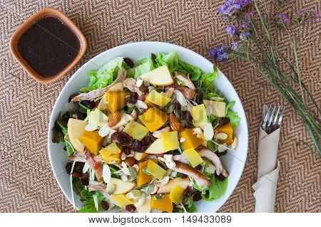Chicken salad with roasted vegetables and mixed greens. Delicious healthy eating.