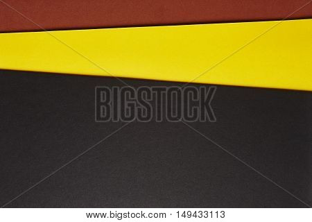 Colored cardboards background black yellow red tone. Copy space. Horizontal