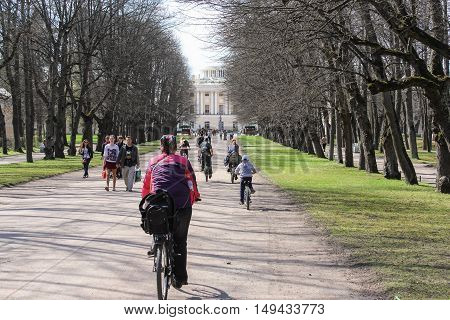 St. Petersburg, Russia - 3 May, People on bikes, 3 May, 2016. People and spring landscape in Pavlovsk park.