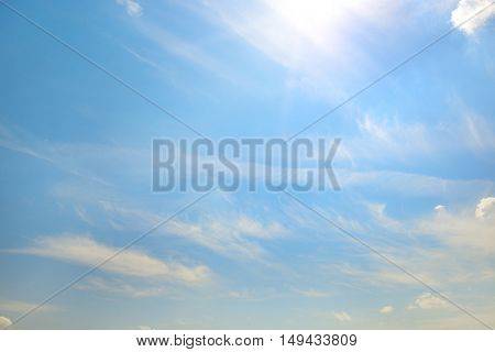 Blue sky with bright sun. Heavenly background.