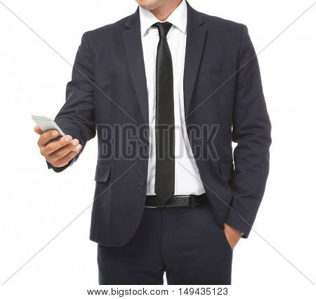 Businessman holding phone in hand on white background