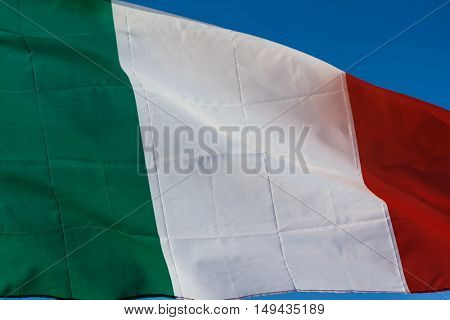 Italian Flag Blowing In The Wind, Waving Flag Of Italy, Europe, Italian Republic, Italy Flag Of Silk On Blue Sky Background, Green, White And Red Are National Colors Of Italy.  National Flag Of Italy