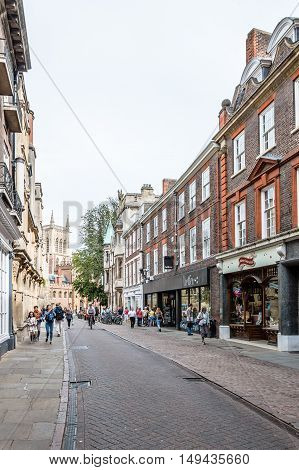 CAMBRIDGE UK - AUGUST 11 2015: Street in Cambridge with tourist and students. Cambridge is a university city and one of the top five universities in the world.