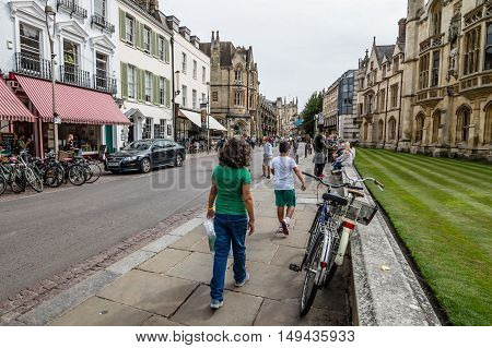 CAMBRIDGE UK - AUGUST 11 2015: People in a Street in Cambridge. Cambridge is a university city and one of the top five universities in the world.