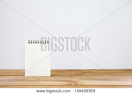 white paper notes on a wooden table