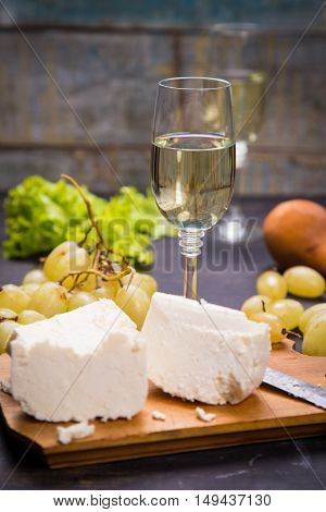 white cheese grape and lettuce with white wine