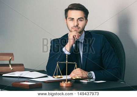 Handsome young man working in modern office
