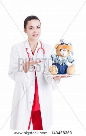 Smiling Female Medic Presenting Plush Toy